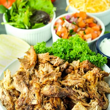 Crispy Pork Carnitas are baked low and slow until fall apart delicious, then finished under the broiler so the edges are caramelized and extra crisp. #mustlovehomecooking