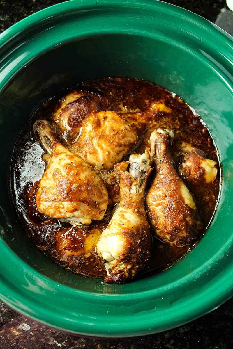 Slow Cooker Barbecue Chicken is made easy in the crock pot with moist chicken legs and an addictive savory sweet barbecue sauce.  #mustlovehomecooking