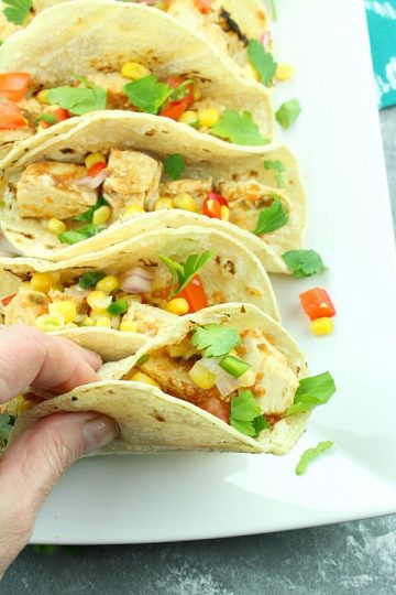 Slow Cooker Habanero Chicken Tacos - Piled high with chunks of juicy chicken and corn salsa, they are a smoldering treat for the taste buds!