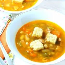 Three Bean Ham Soup in white bowl
