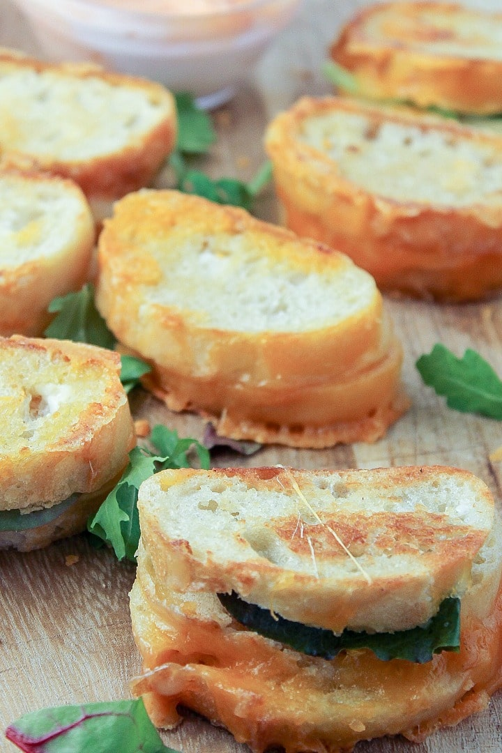Dripping with gooey cheese, 20 Minute Mini Grilled Cheese Appetizers are a twist on the classic that everyone will love. Make a bunch of these diner-style specials because they disappear fast and your crowd will be clamoring for more!