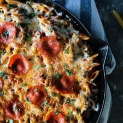 One Pan Pepperoni Pizza Pasta let's you enjoy the taste of your pasta and pizza favorites in the same dish! Spicy pepperoni, velvety pasta and oozing melted cheese makes this 30 minute recipe an easy choice to add to your favorites!