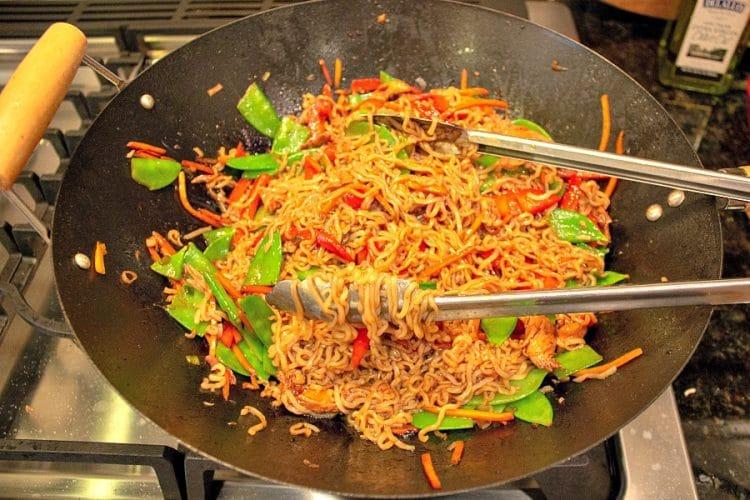stir fry vegetables a ramen noodles in a wok