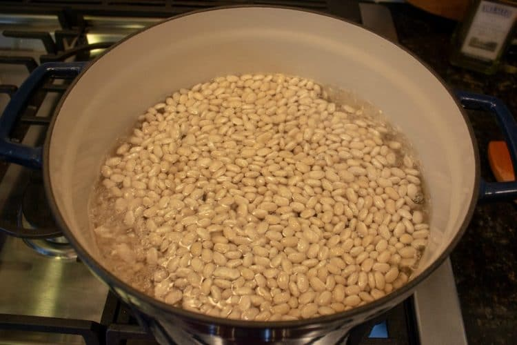 dry beans covered with water in pot