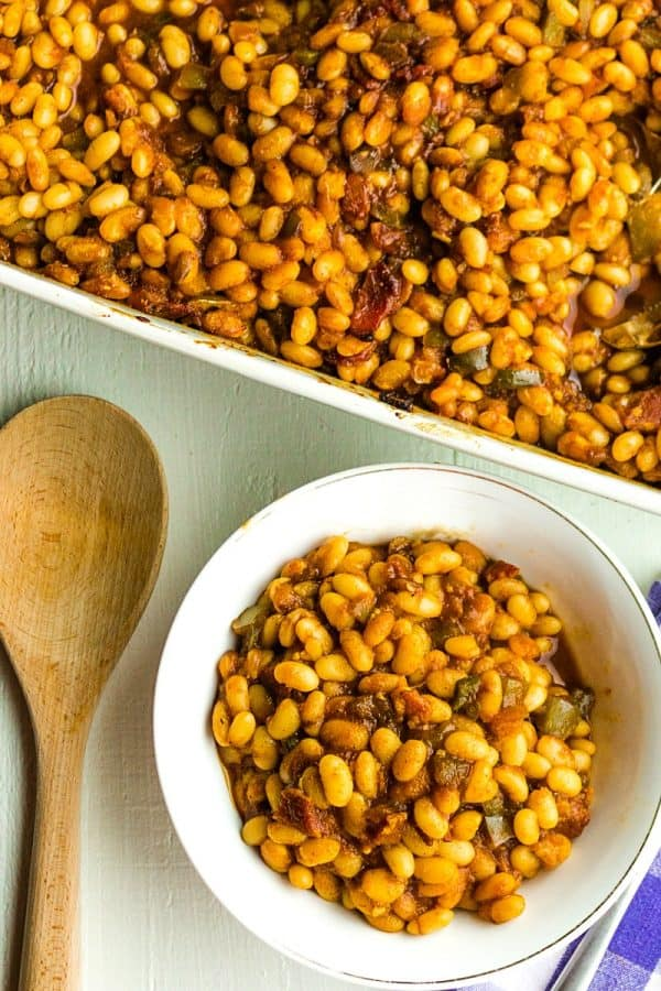 A classic brown sugar, vinegar and mustard syrup makes these From Scratch Cola Baked Beans a hit every time!