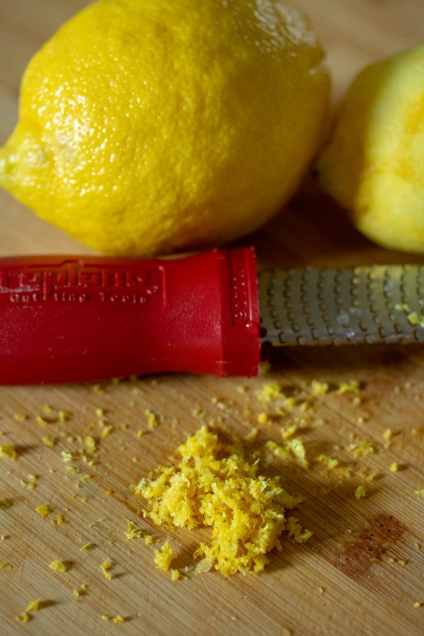 lemon zest with lemons and microplaner