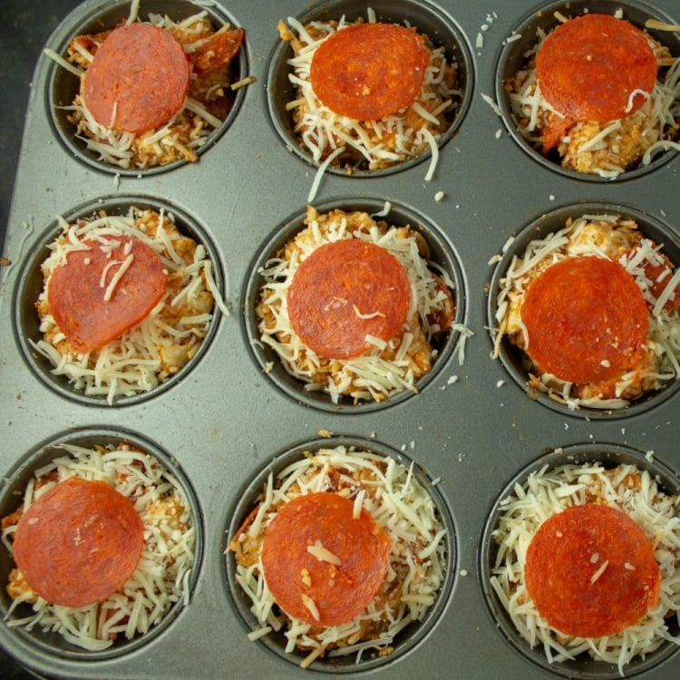 pizza poppers ready for oven in muffin tray
