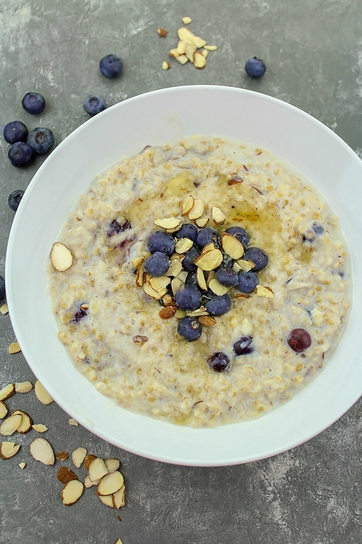 Slow Cooker Blueberry Almond Oatmeal, a super healthy breakfast made with milk, steel cut oats, fresh blueberries, honey and cinnamon. Kid tested goodness!