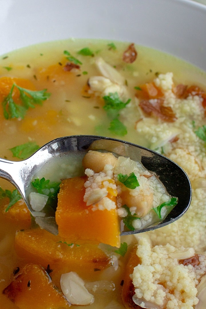 Savory Butternut Squash Bean Soup is a savory protein-packed blend of butternut squash, white beans, chickpeas and couscous. Warm, comforting and so tasty this will be a favorite family soup.