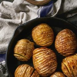 Easy Baked Hasselback Potatoes are tender, crispy sliced potatoes dripping with butter and herbs.