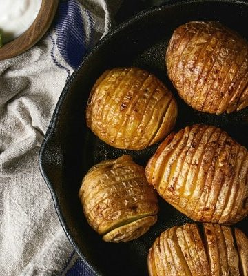 baked hasselback potatoes in cast iron skillet