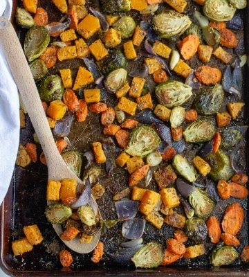 roasted vegetables on a pan with parmesan olive oil and garlic
