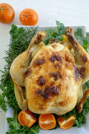 Slow Cooker Whole Chicken recipe is a deliciously seasoned Sunday dinner style chicken made in the crock pot.