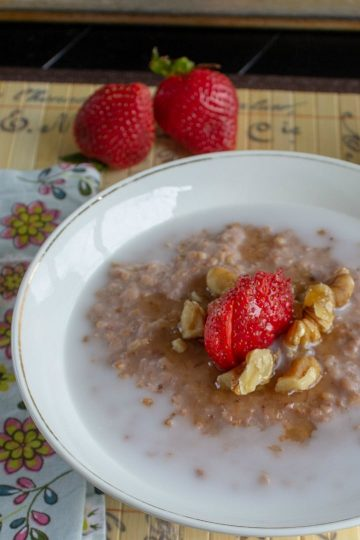 Breakfast is ready with Easy Slow Cooker Strawberry Honey Oatmeal. Steel cut oats, fresh strawberries and raw honey  are slow cooked into  a smooth and creamy bowlful of delicious. Make ahead for the entire week!