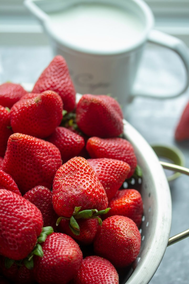 Whole ripe strawberries in colander