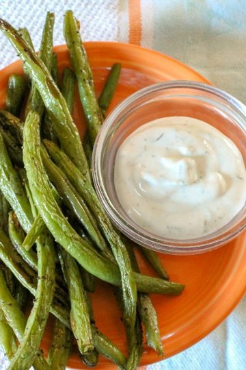 Zesty Green Bean Dippers are oven roasted, spicy green beans roasted in the oven until crispy, served with fat-free dill dip! Only 38 calories a serving, including dip!