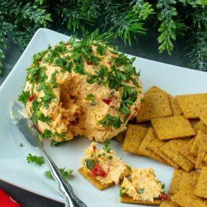 Try this festive Roasted Red Pepper Ranch Cheese Ball for your next gathering. Easy to make with only a handful of ingredients!