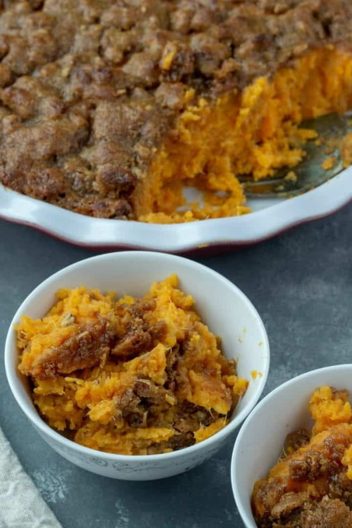 Whipped Sweet Potato Pecan Casserole - A crunch topped seasonal favorite, made deliciously light by sweetening with bananas. Make ahead and freezer friendly too!