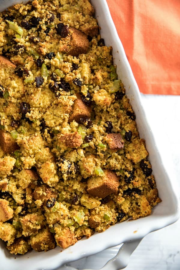 Southern Cornbread Stuffing (aka Dressing) made with vegetables, spices and plump raisins is from a favorite West Virginia family recipe. #mustlovehomecooking
