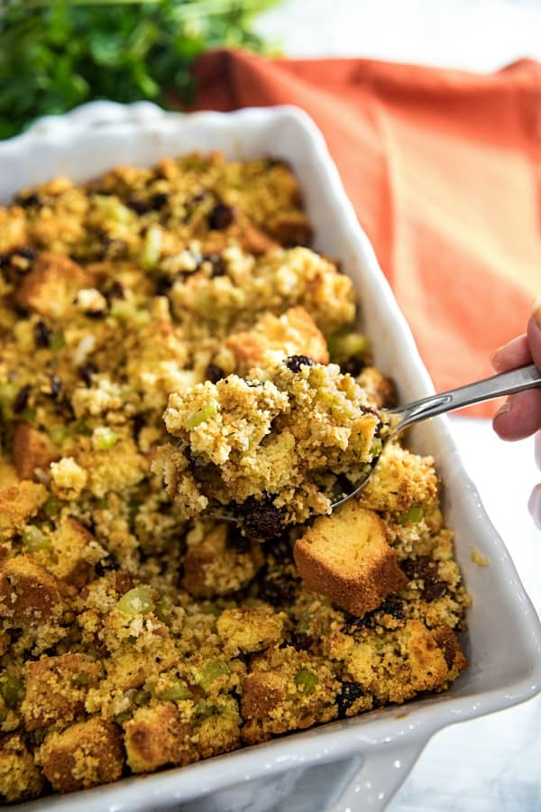 Southern Cornbread Stuffing (aka Dressing) made with vegetables, spices and plump raisins is from a favorite West Virginia family recipe.