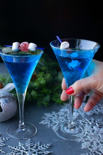 This gorgeous Jack Frost Martini is an excellent addition to any holiday party. It's a classic martini with a chilly blue curacao twist!