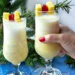 Snow Day Pina Colada is a smooth and delicious winter cocktail made with rum, coconut cream and a healthy shot of peppermint schnapps!