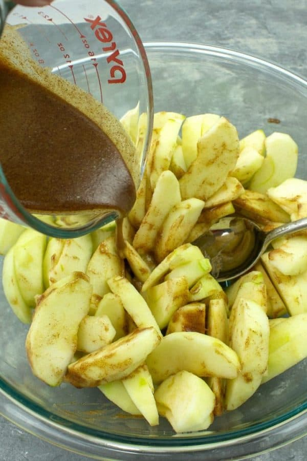 Thinly sliced apples coated with brown sugar syrup