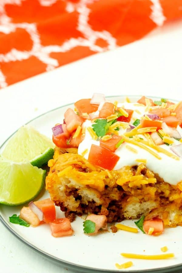 Soft and chewy, filled with spicy ground beef and oozing with cheese, this Taco Biscuit Casserole is an amazing addition to the taco night lineup!