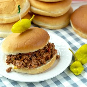 Slow Cooker Sloppy Joes, made with ground beef soaked in a savory sauce of  tomatoes, ketchup, barbecue sauce and spices. Makes enough to feed a crowd or to freeze for later!