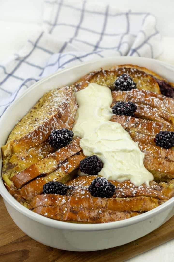 Blackberry Cream French Toast smothered with cream sauce and fresh balcberries