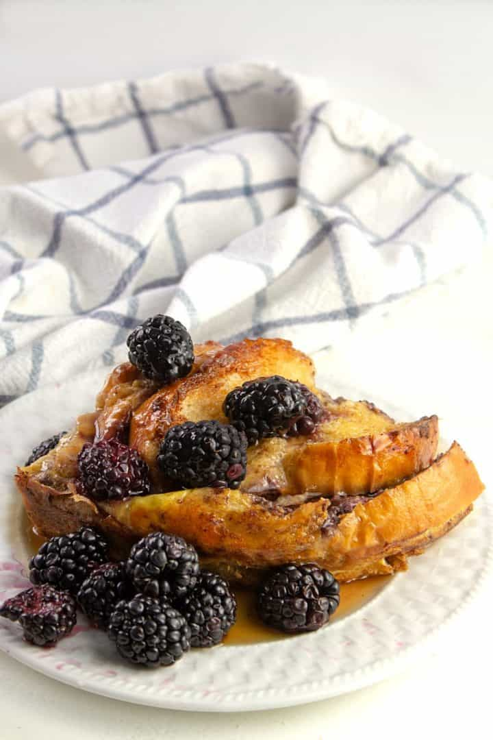 Blackberry covered oven french toast with maple syrup