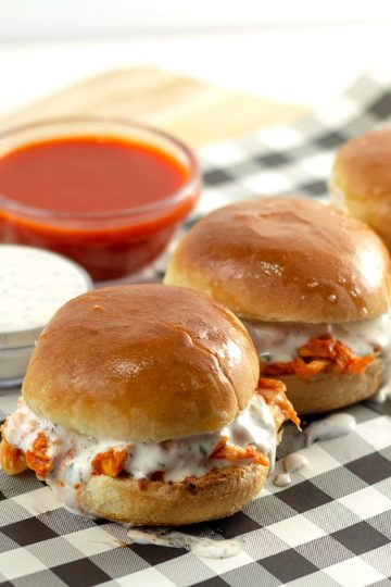 GET THE PARTY STARTED WITH THESE SPICY SLIDERS OOZING WITH MELTED CHEESE AND HOMEMADE BUTTERMILK RANCH DRESSING