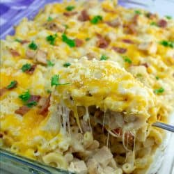 Baked Mac and Cheese gets a simple comfort food twist by adding chicken, crispy bacon and ranch seasoning!
