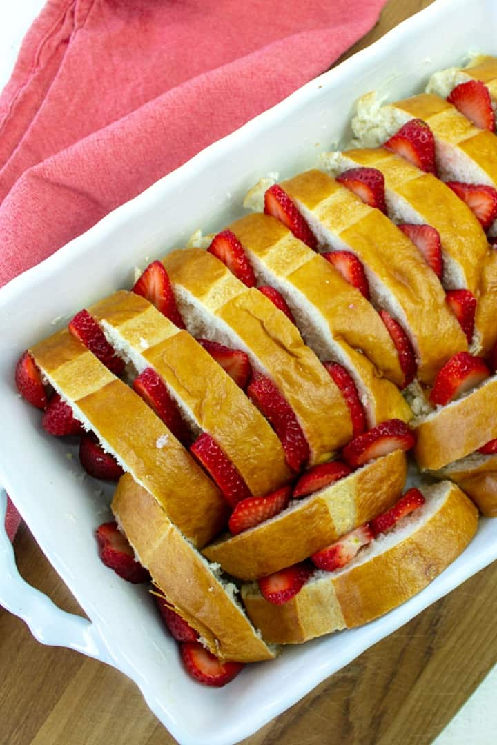 bread slices and strawberries in baking pan