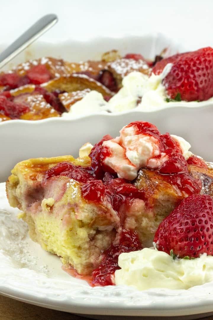 french toast with whipped cream and strawberry syrup