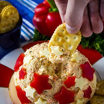 Easy Patriotic Ranch Cheese Ball is a quick appetizer decorated for your summer celebrations! Makes enough for a crowd! #mustlovehomecooking
