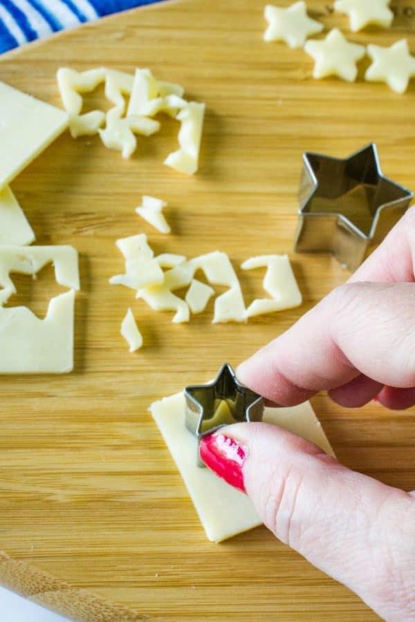 making tin star shape cutouts of cheese