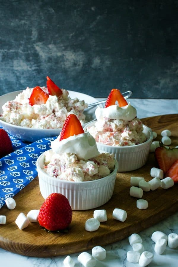 Strawberry Cheesecake Fluff Recipe -Fresh strawberries, Greek yogurt, cheesecake pudding mix, marshmallows and whipped topping come together in minutes for a quick and easy dessert or side dish!
