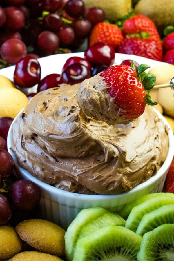 Chocolate Lovers Fruit Dip is a cool and creamy treat made with melted chocolate, cocoa, cream cheese and luscious whipped cream. This delicious chocolate dip is great for parties, dessert or after school snacks! #mustlovehomecooking