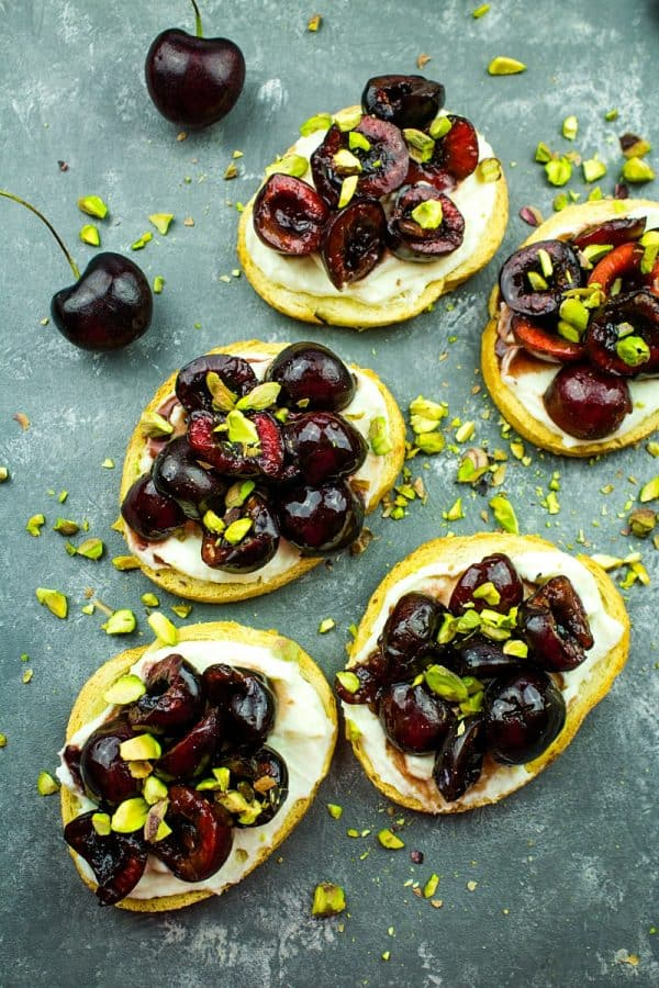 Cherry Pistachio Ricotta Crostini - Crisp toasts, cherries, sweetened ricotta and pitachios are layered to make these fabulous elegant party appetizers!