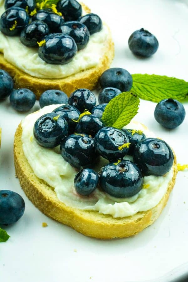Blueberry Honey Whipped Ricotta Crostini -Blueberries, ricotta cheese and honey are paired to make this elegant perfect party appetizer!
