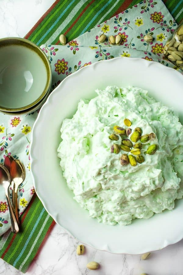 Pistachio Pineapple Fluff - aka Watergate Pudding, is a luscious holiday dessert of whipped topping, pudding mix, pineapple, marshmallow and pistachios.