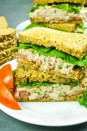 Loaded with tuna, crunchy sweet red pepper, green onions, celery, relish and seasonings, this tasty Classic Tuna Salad Recipe is great for a light meal or anytime snack! #mustlovehomecooking