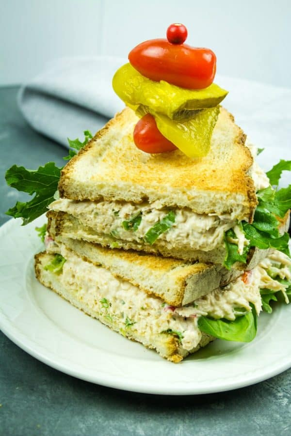 Best Ever Chicken Salad - Shredded chicken, red bell pepper, green onions, celery, nuts and seasonings make this classic salad a tasty anytime sandwich topping!