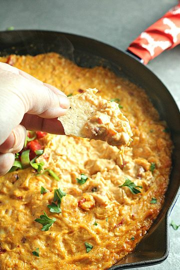 Creamy and cheesy, this Buffalo Chicken Dip is a favorite spicy party appetizer. Simple to make with ingredients like shredded chicken, wing sauce, ranch dressing and mozzarella cheese.