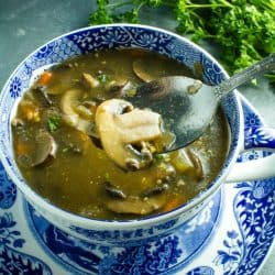 An earthy, full of flavor, healthy mushroom soup, made with mushrooms, vegetables, seasonings and broth is just right for a cozy meal.