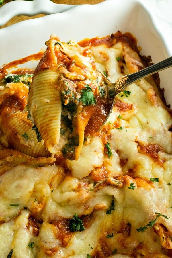 Healthy red pepper spinach stuffed shells made ahead for an easy family freezer meal.