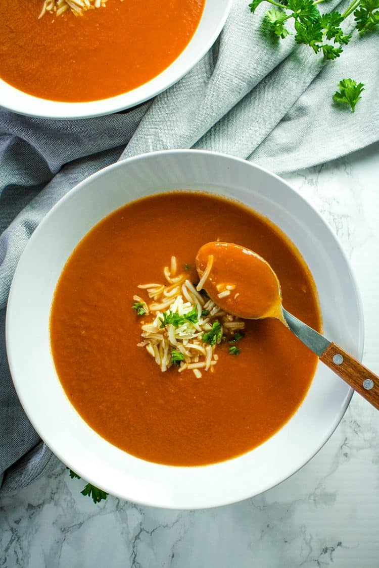 Onion, tomatoes, garlic and butter are all you need to make homemade tomato soup. It's a thick and delicious soup that comes together in under an hour.