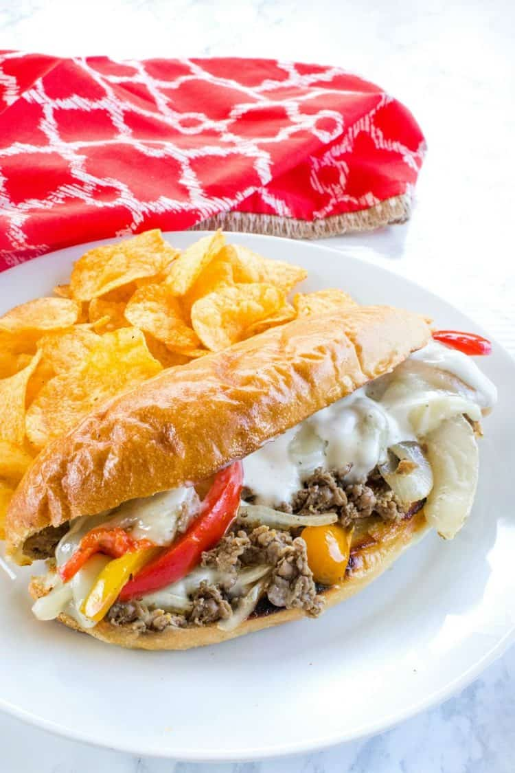 This easy freezer meal Philly cheese steak is the BEST! With tender shaved steak, peppers, onions and spices it's everything you could want in a freezer meal - delicious, pan ready and served in minutes.