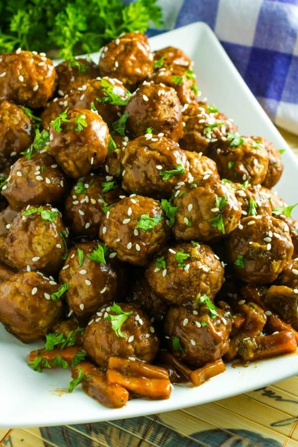 Slow Cooker Asian Barbecue Meatballs with frozen meatballs, vegetables, teriyaki sauce, barbecue sauce and sriracha are just what you need to make these sweet and spicy meatballs.